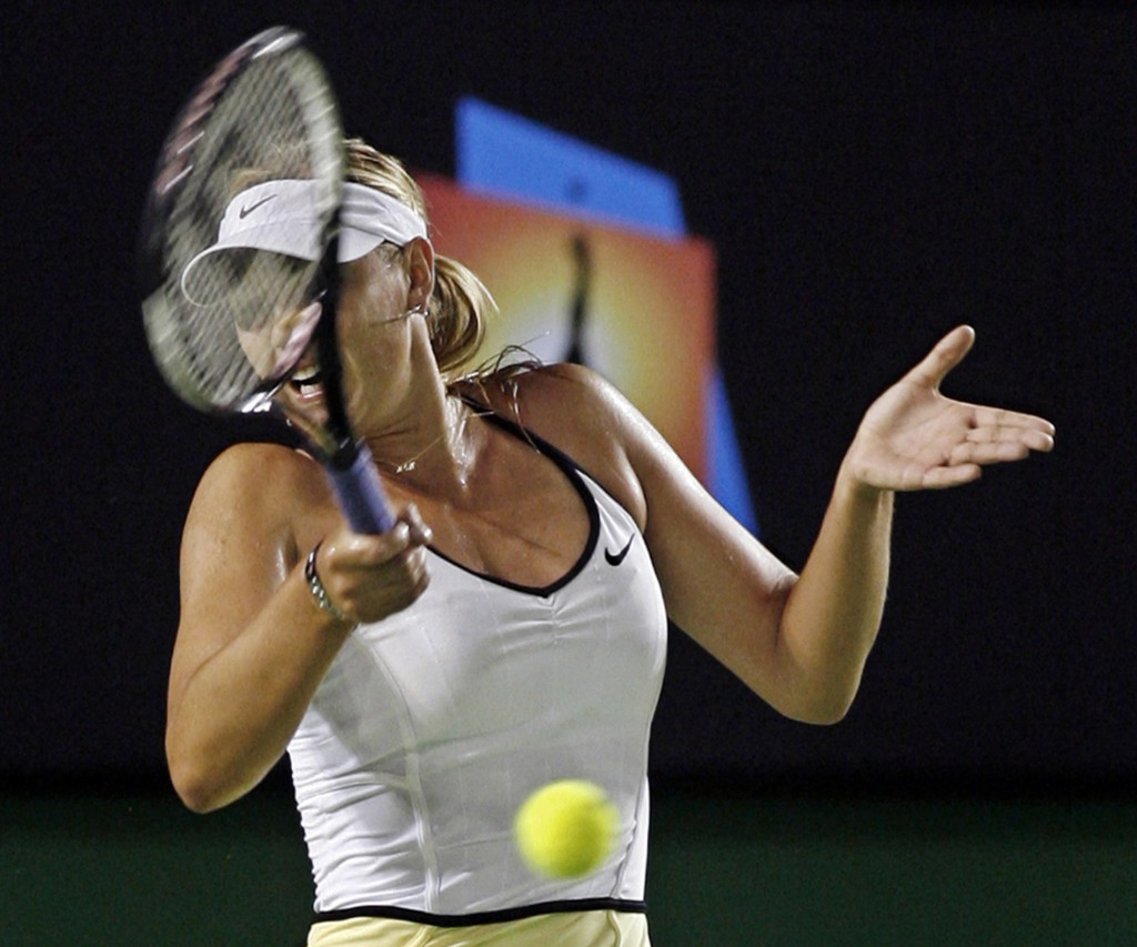 Russia's Sharapova plays a shot during her match against Italy's Garbin at the Australian Open tennis tournament in Melbourne