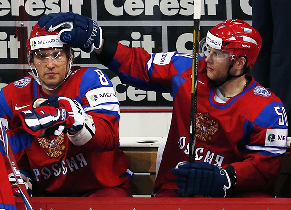 Russia's Ovechkin gets a pat on the head by Soin after judges validated his goal against Team USA during their 2013 IIHF Ice Hockey World Championship quarter-final match at the Hartwall Arena in Helsinki